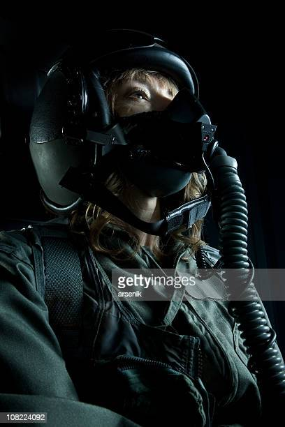 Female Fighter Plane Pilot Wearing Helmet and Oxygen Mask
