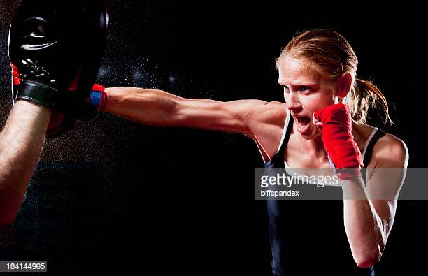 Female Fighter Throwing A Punch