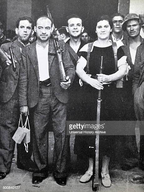 A female fighter with republican soldiers during the Spanish civil war Barcelona 1937
