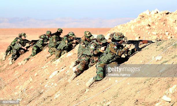 Female fighters aim their rifles as the Syrian Peshmerga fighters are being trained to fight against Daesh and Assad forces at a camp located in Old...