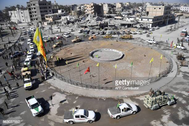 TOPSHOT Female fighters of the Syrian Democratic Forces gather during a celebration at the iconic AlNaim square in Raqa on October 19 after retaking...