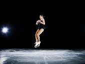 Female figure skater jumping in mid air