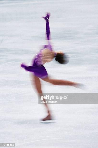 Female Figure Skater spinning on ice (Digital Enhancement)