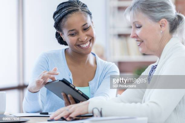 Female financial advisor counsels senior client
