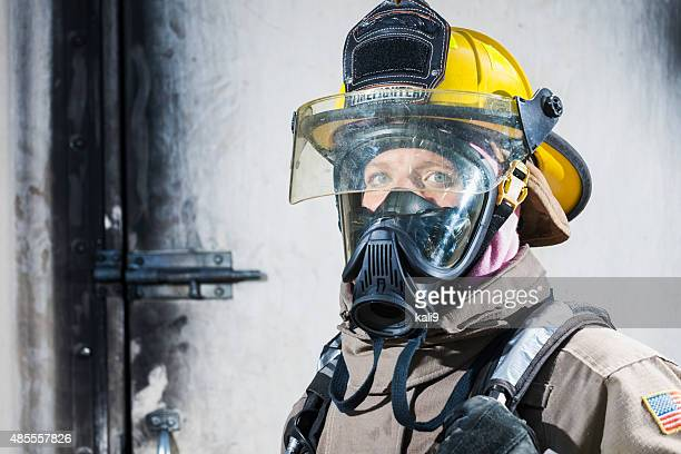 http://media.gettyimages.com/photos/female-firefighter-in-protective-gear-and-oxygen-mask-picture-id485557826?s=612x612