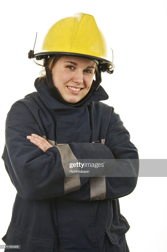 Female firefighter with yellow hat and black coat : Stock Photo
