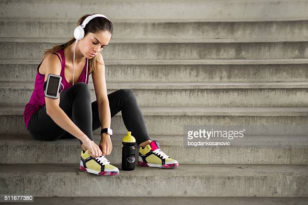 Female fitness athlete tying shoe lace