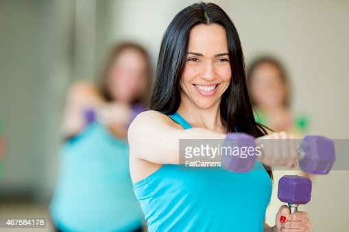 Female Fitness Class with Free Weights