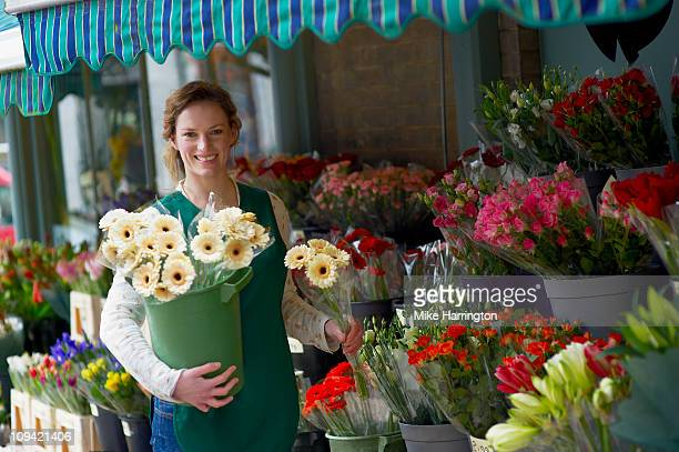 Female Florist Holding a Selection of Flowers