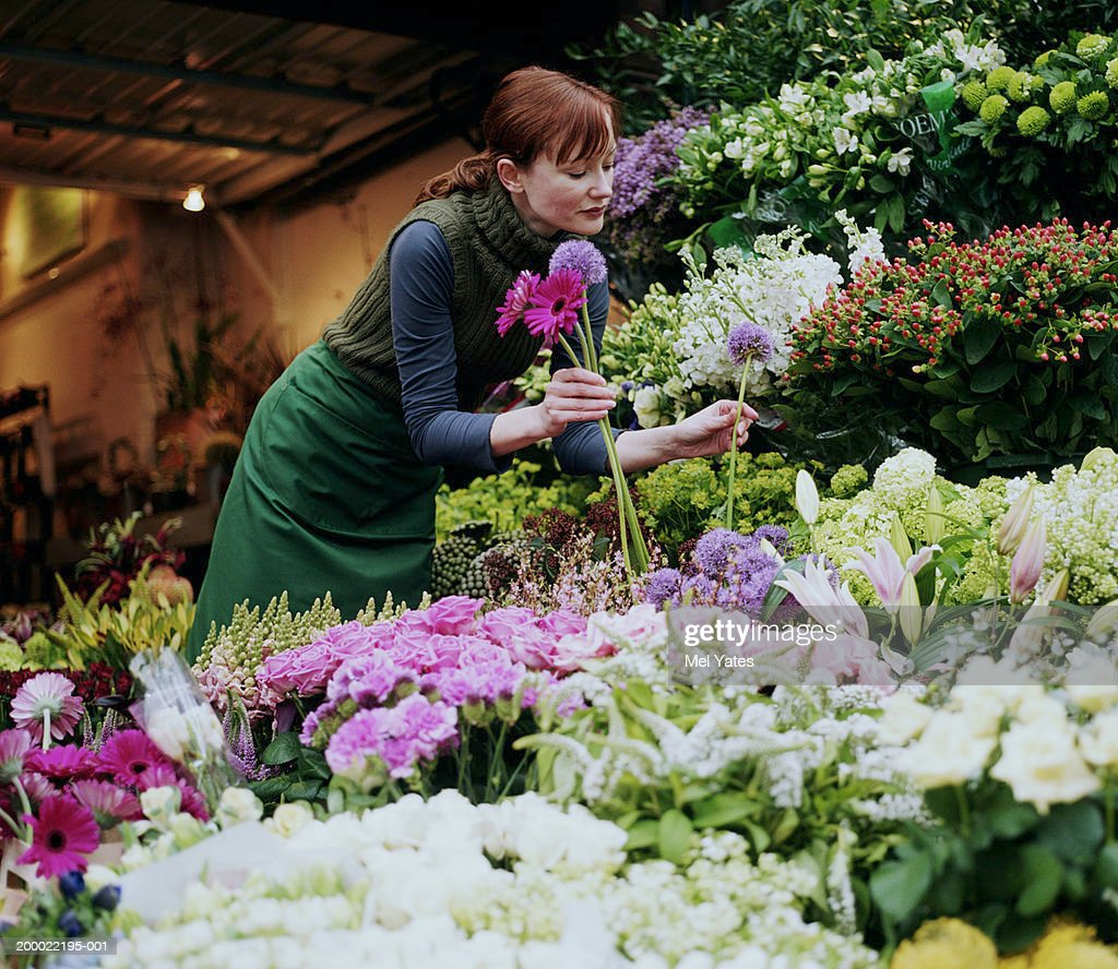 Female florist selecting flowers