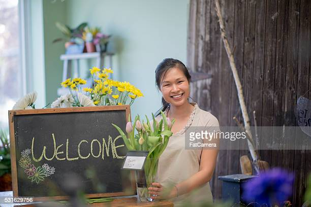 Female Florist Standing in Her Shop