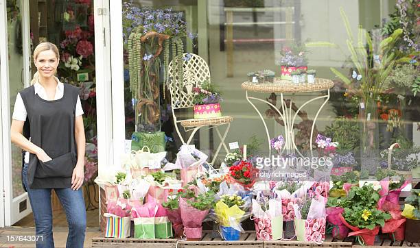 Female Florist Standing Outside Shop
