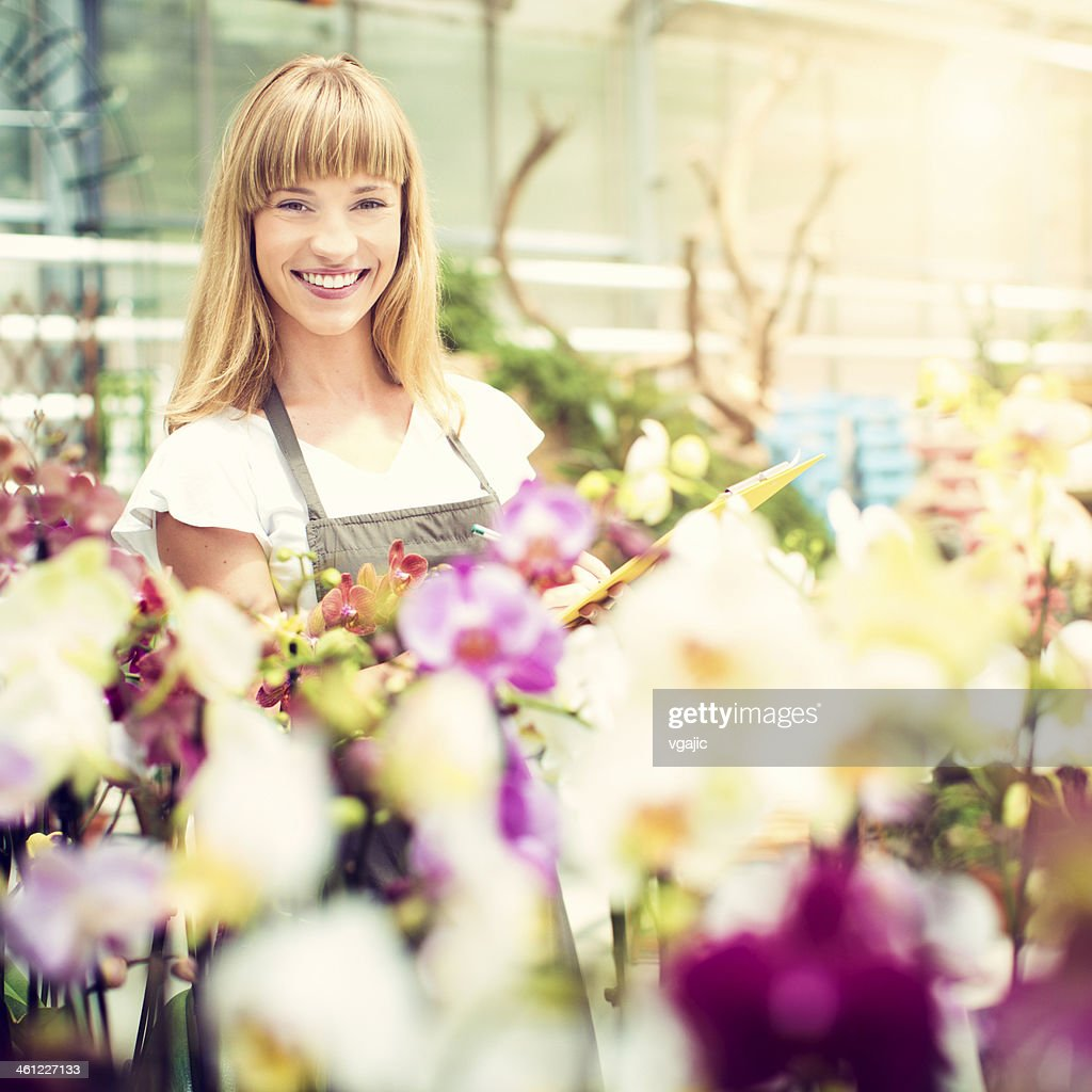 Female Florist Working At Garden Center.