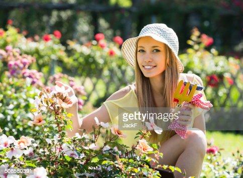 Female florist working in garden : Stock Photo