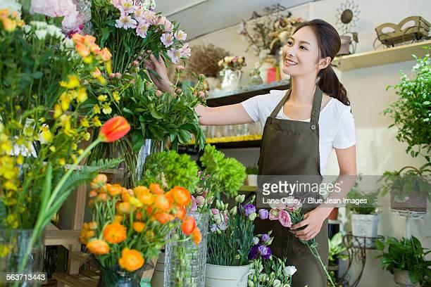 Female florist working in shop