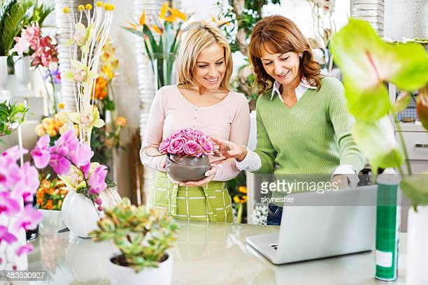 Female florists in a flower shop.