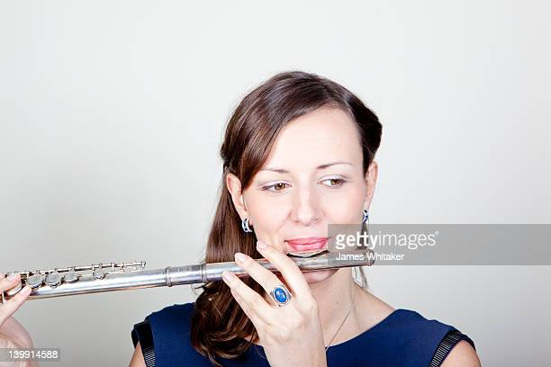 Female Flute Player tunes up