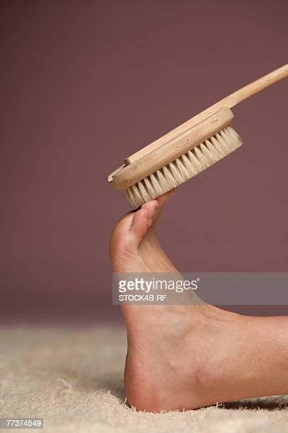 Female foot balancing brush
