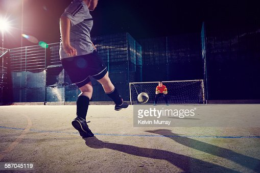 A female football player takes a shot in training