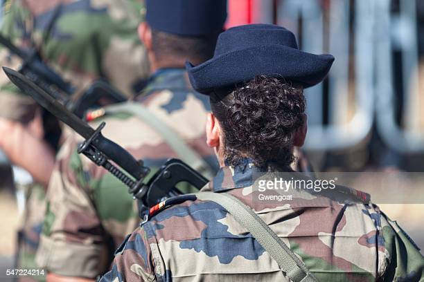 Female French soldier parading