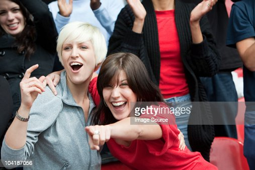 Female friends at football match : Stock Photo