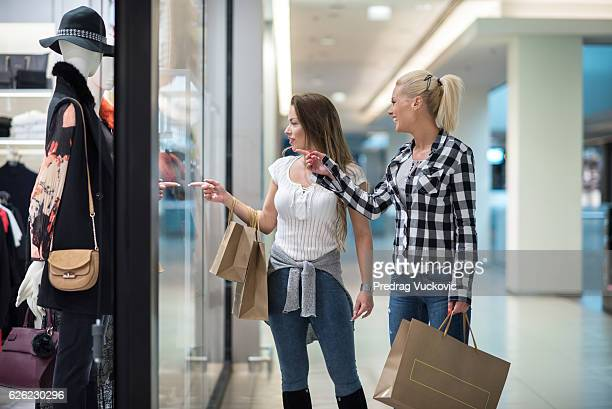 Female friends in shopping mall