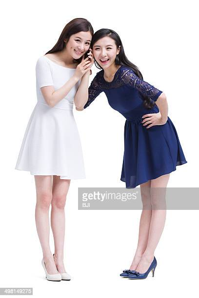 Female friends listening to phone together