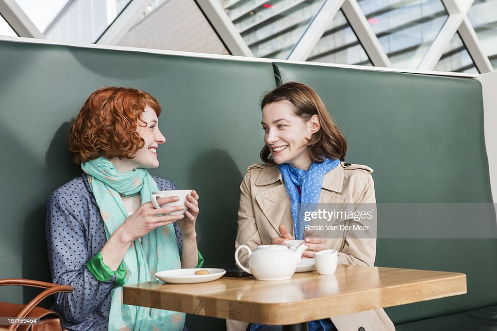 Female friends meeting up in cafe for chat. : Stock Photo