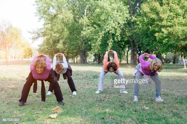 Female Friends over fifty exercising outdoors