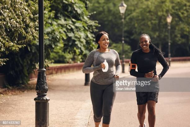 Female friends running in the park