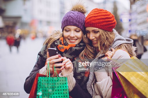 Female friends shopping in city.