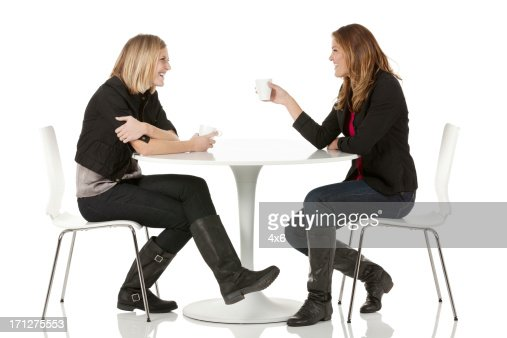 Female Friends Sitting In A Restaurant Stock Photo Getty