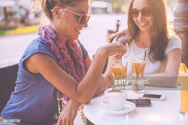 Female friends talking in cafe