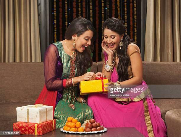 Female friends unpacking gifts on Diwali