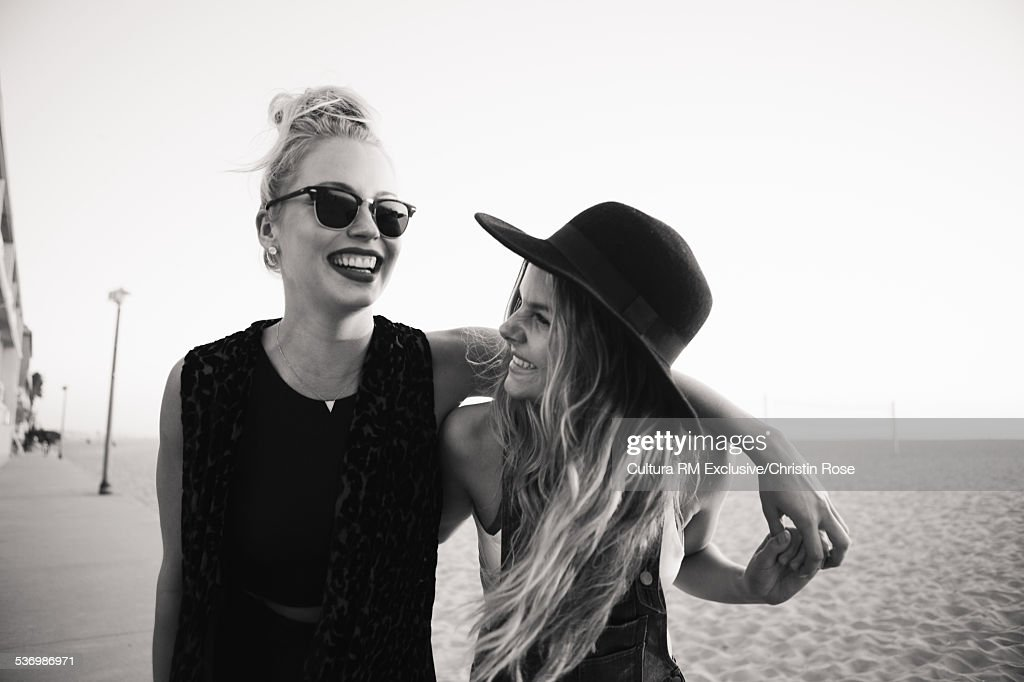 Female friends with arms around each other : Stock Photo