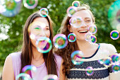 Female friends with bubbles.