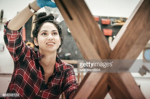 Female furniture designer at woodworking studio : Stock Photo
