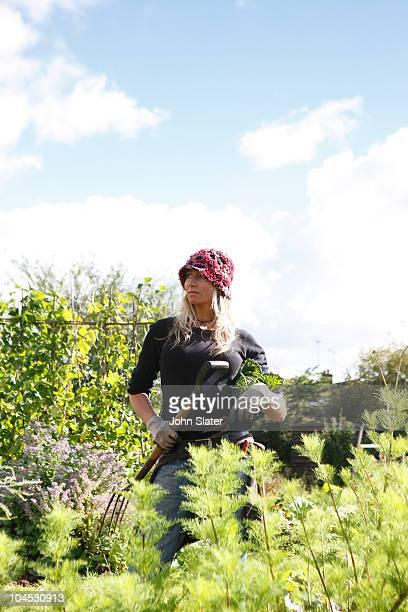 female gardener in allotment