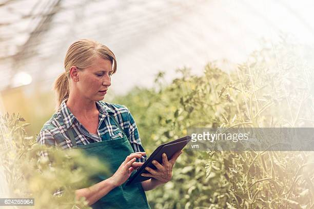 Female gardener with digital tablet