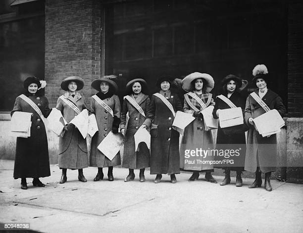 Female garment workers in Cincinnati sell newspapers to support their fellow workers in the International Ladies' Garment Workers' Union who are...