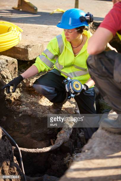 female gas engineer in trench
