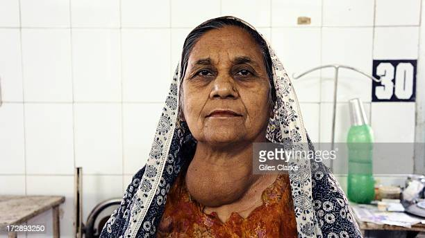 A female gas victim languishes in the poorly funded and ill equipped Shakir Ali Khan Hospital a staterun 'gas hospital' December 3 2012 in Bhopal...