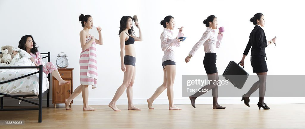 Female getting ready for work, different stages : Stock Photo