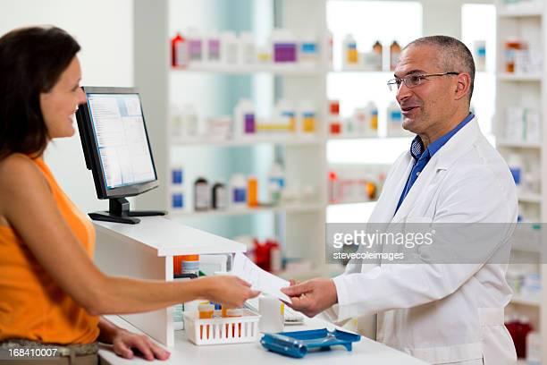 Female Giving Druggist Prescription to be Filled