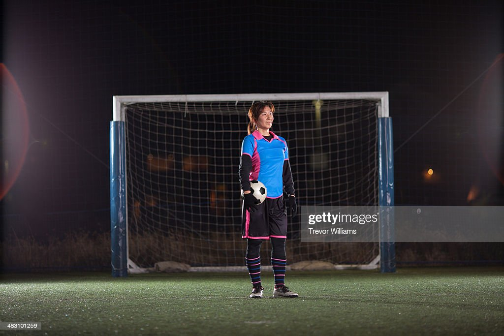 female goalkeeper with ball in front of the goal : Stock Photo