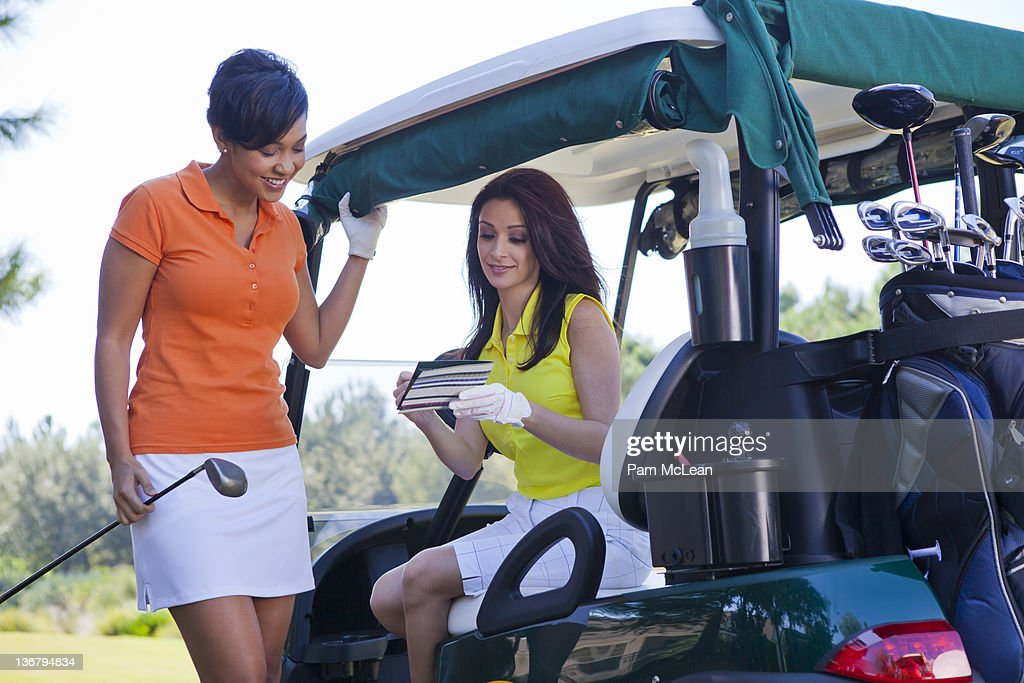 Female golfers filling out score card : Stock Photo
