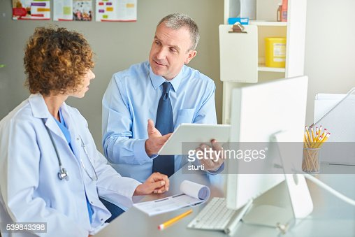 female gp with administrator