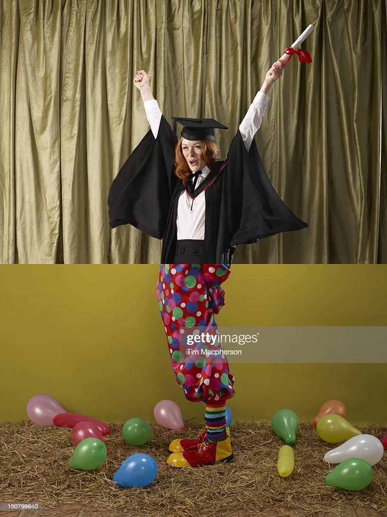 Female graduate top, clown bottom