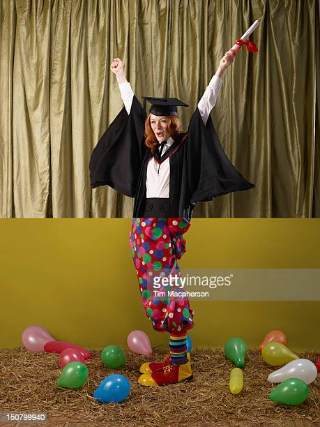 Female graduate top, clown bottom