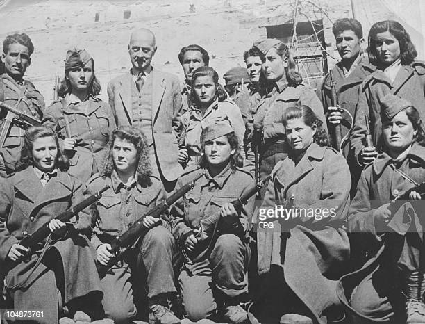 Female Greek partisan fights during the Greek Civil War July 1947 With them is Belgian Lieutenant General Maurice Delvoie head of an investigating...